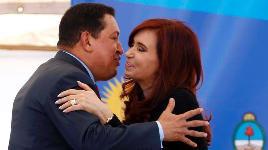 Venezuela's President Hugo Chavez, left, and Argentina's President Cristina Fernandez greet after signing commercial accords during a visit to a state-run shipyard in Buenos Aires, Argentina, Tuesday, March 29, 2011. Chavez is on a one-day official visit to Argentina. (AP Photo/Natacha Pisarenko)