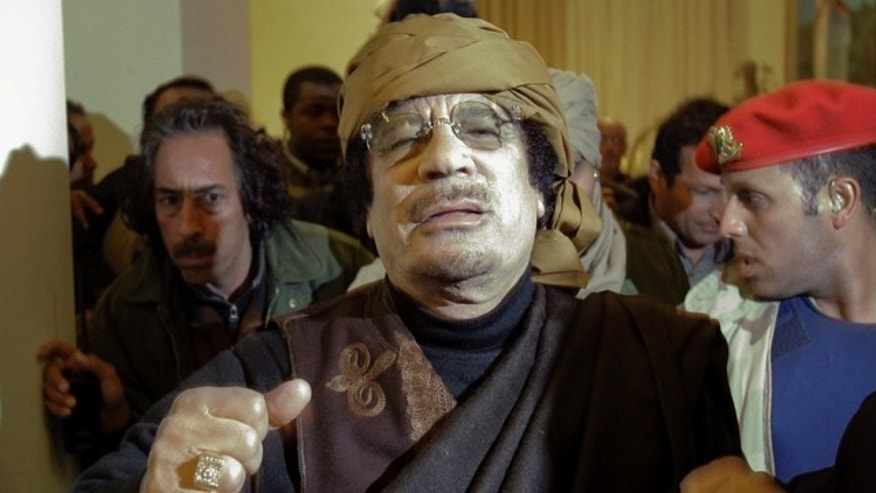 March 8: Libyan Leader Muammar Qaddafi arrives at a hotel to give television interviews in Tripoli, Libya.
