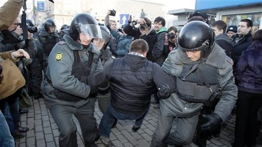 March 31: Riot police officers detain a demonstrator during an unauthorized rally at the Triumfalnaya Square  in Moscow. Riot police in Moscow have forcefully detained about 25 protesters who unfurled an anti-government banner at an unauthorized demonstration. Thursday's demonstration was the latest in a series of actions that Russian opposition figures call at the end of every month with 31 days. The number corresponds with Article 31 of the Russian Constitution, which guarantees freedom of assembly. (AP)
