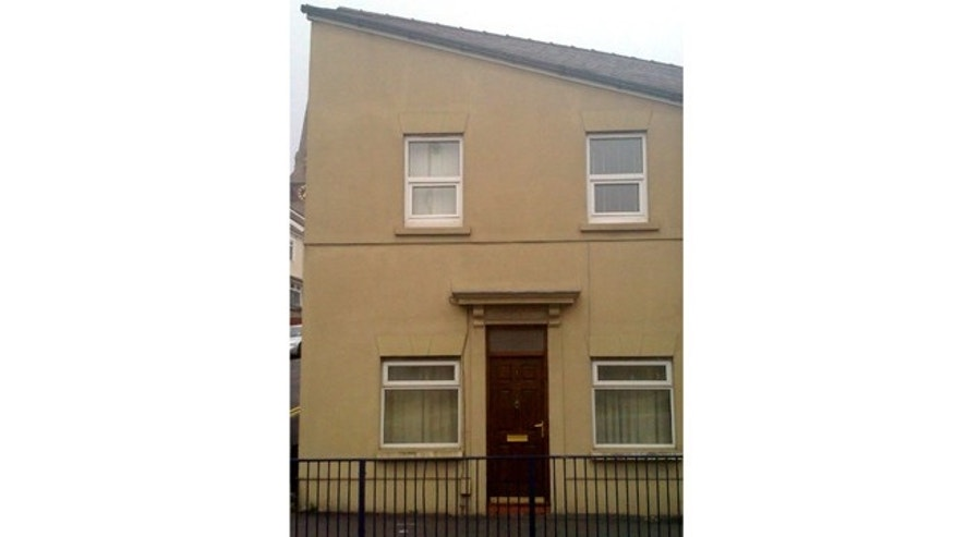 This house, resembling the distinctive facial features of German World War II leader Adolf Hitler, has become an unlikely hit on the internet.  The end of terrace property in Swansea, Wales, has turned heads among locals, with the lintel above the door echoing the toothbrush moustache of the Nazi dictator and the black sloping roof resembling his hair. Photographs of the building, posted on social networking site Twitter, have been viewed more than 65,000 times.