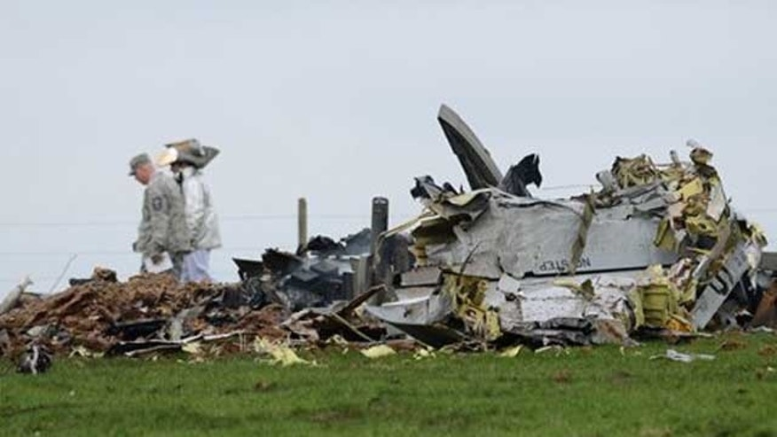 The debris of a crashed US military plane lies in a field near Laufeld, western Germany Friday, April 1, 2011. A police spokesman said the pilot ejected before the crash. He was injured and hospitalized. The spokesman identified the plane as a Warthog _ an A-10 Thunderbolt.