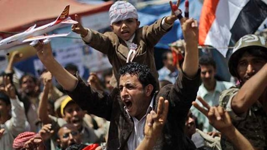 Anti-government protestors shout slogans during a demonstration demanding the resignation of Yemeni President Ali Abdullah Saleh, in Sanaa, Yemen, Thursday, March 31, 2011. Mass protests have been shaking Yemen for weeks, with demonstrators inspired by successful uprisings in Egypt and Tunisia seeking the ouster of their own autocratic ruler, President Ali Abdullah Saleh who has served for 32 years.