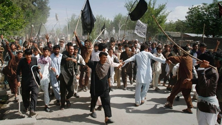 April 4: Afghan protestors march during a demonstration in Laghman east of Kabul, Afghanistan. Protests erupted in Afghanistan again Monday against a Florida pastor's burning of the Koran, making four straight days of demonstrations -- some deadly -- against the destruction of Islam's holy book in a country struggling to beat back an insurgency led by Taliban religious extremists. (AP)