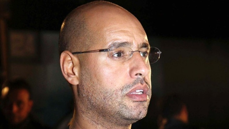 Feb. 22: Saif al-Islam Qaddafi, son of Libyan leader Muammar al-Qaddafi, waits before a press conference in Tripoli, Libya.