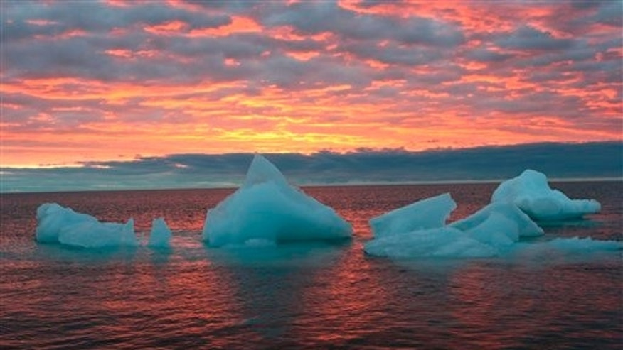 In this Sept. 13, 2006 file photo, ice chunks float in the Arctic Ocean near Barrow, Alaska.