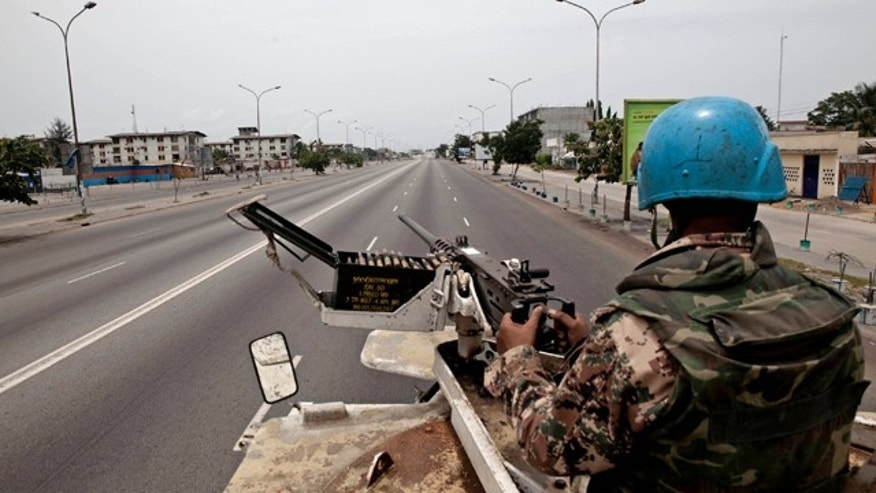 April 3: A U.N. peacekeeper from Jordan patrols the streets of Abidjan, Ivory Coast.