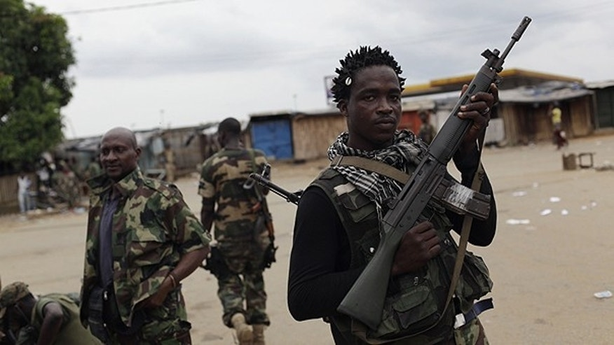 April 5: Soldiers loyal to Alassane Ouattara occupy an area of the Youpougon neighborhood, near a checkpoint at the main northern entrance to Abidjan, Ivory Coast