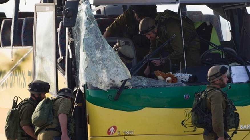 April 8: Israeli soldiers inspect a school bus hit by an anti-tank missile fired from the Gaza Strip near the border between southern Israel and Gaza at Sa'ad, Israel.