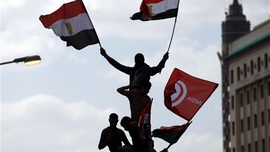 April 8: Egyptians wave Egyptian and Tunisian flags as they attend a rally in Tahrir square in Cairo, Egypt. Protesters held a mock trial of Hosni Mubarak, his family and his top aides in Cairo's central Tahrir Square where tens of thousands of Egyptians massed demanding the ruling military prosecute them for alleged corruption in one of the country's largest rallies since the longtime president was ousted two months ago. (AP)