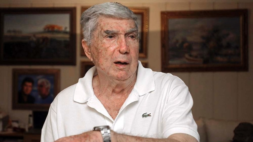 In this photo taken Nov. 8, 2010, Luis Posada Carriles talks to a reporter in Miami. As he prepares for trial Monday, Jan. 10, 2011 in El Paso, Texas, on federal charges connected to the decade-old bombings that killed an Italian tourist, Posada's art says much about the cagey former CIA asset who remains a lightning rod in much of Latin America. (AP Photo/Alan Diaz)