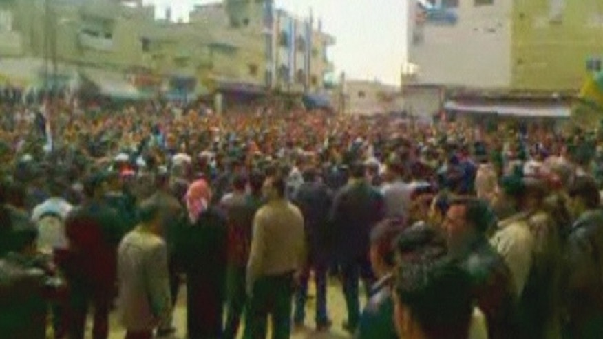 April 8: Amateur video shows protesters taking to the streets in Daraa, Syria.