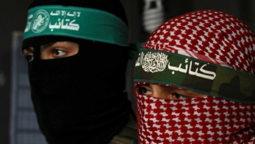 April 9: Masked Palestinian Hamas militants hold a press conference in Gaza City.