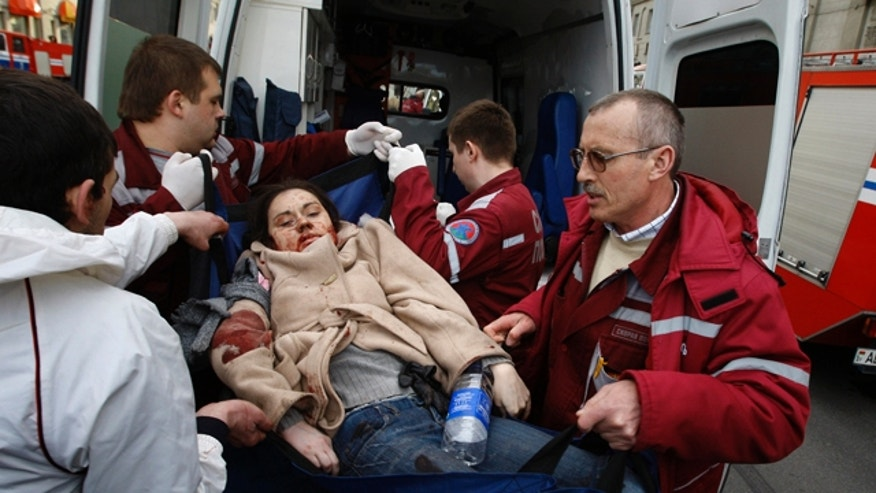 April 11: A wounded blast victim is brought by rescuers to an ambulance vehicle in Minsk, Belarus. An explosion tore through a subway station in the Belarusian capital during evening rush hour Monday, and an official in the presidential administration said there were fatalities. (AP)