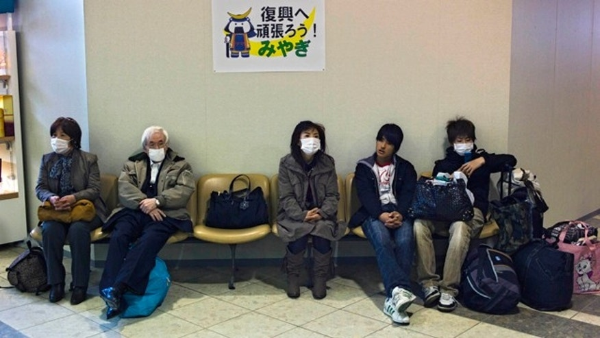 April 13: Passengers wait for departure in Sendai airport in Natori city, near Sendai, Miyagi Prefecture, Japan. Commercial flights to this coastal city resumed partially Wednesday, just over a month after a 32-foot tsunami scoured the airport's runways. (AP)