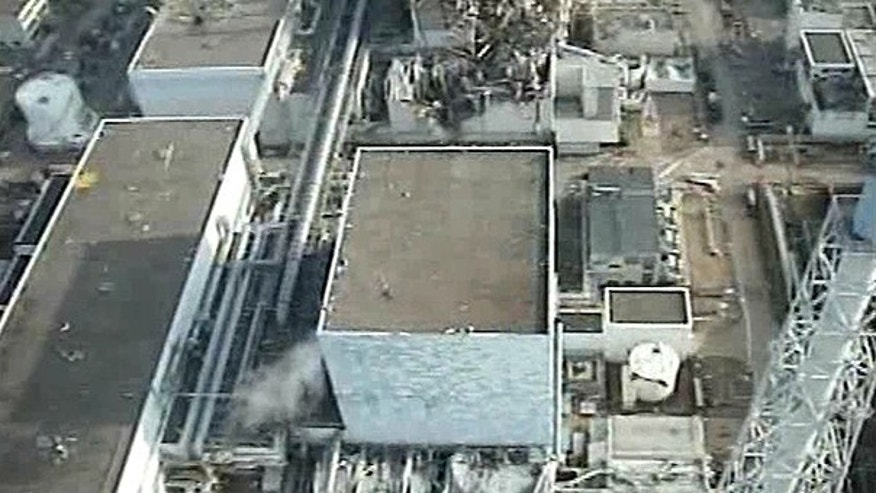 This Sunday, April 10 image taken by T-Hawk drone aircraft and released by Tokyo Electric Power Co. (TEPCO) shows the reactor building of Unit 2, center, of the tsunami-crippled Fukushima Dai-ichi nuclear power plant in Okuma town, Fukushima Prefecture, northeastern Japan.