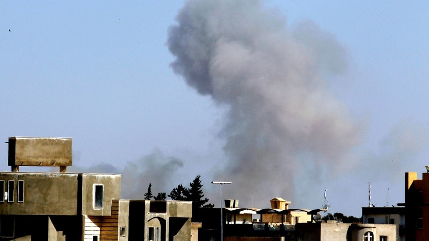 April 14: Smoke rise from an area in southeast Tripoli, Libya, soon after a blast (AP)