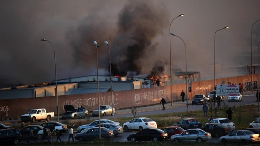 April 15: Fire and smoke rises from storage warehouse at a construction site that is run by a foreign company, with no clear causes of the incident, in Benghazi, Libya.