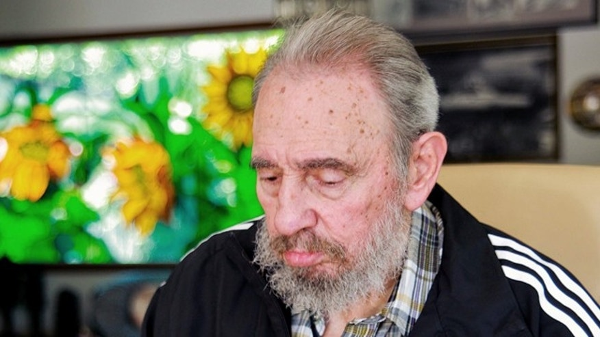 April 18: In this photo downloaded from the state media Cubadebate web site, Cuba's Fidel Castro casts his vote to elect Cuba's new Communist Party Central Committee at his home in Havana, Cuba.