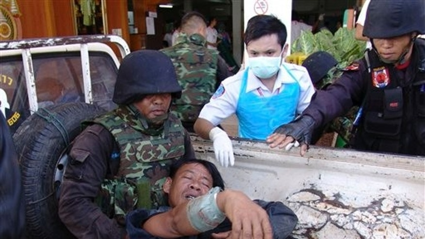 April 22: A Thai soldier injured in a fighting with Cambodia is helped by his comrades and a nurse after arriving at a hospital in Phnom Dongrak district of Surin province, northeastern Thailand. Thailand and Cambodia exchanged artillery and gunfire for several hours along their disputed frontier Friday in a new flare-up of their long-running conflict. It was the first skirmish reported since the two Southeast Asian countries battled for four straight days in February at the 11th century Preah Vihear temple. (AP)