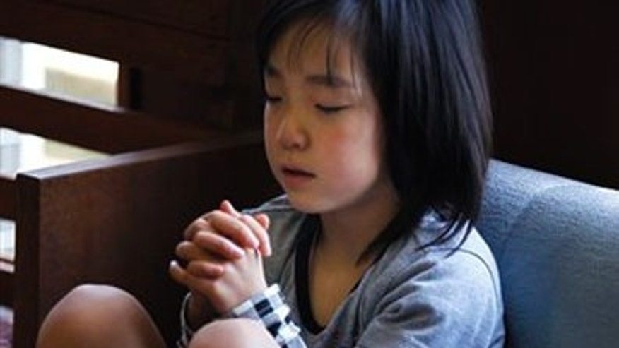 April 24: Renka Hashimoto, 7, prays during the Easter service at Kesennuma Bible Baptist Church in Kesennuma, Miyagi Prefecture, northeastern Japan. This Easter, the story of resurrection carried a deeply personal message for the small community of Christians in disaster-hit Japan. (AP)