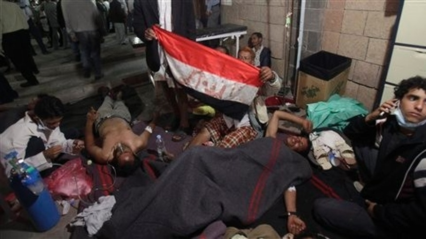 April 27: Wounded anti-government protestors lie on the ground of a field hospital following clashes with Yemeni security forces in Sanaa, Yemen.
