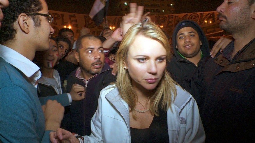 "In a photo released by CBS, ""60 Minutes"" correspondent Lara Logan covers the reaction in Cairo's Tahrir Square the day Egyptian President Hosni Mubarak stepped down. CBS News says Logan was attacked, beaten and sexually assaulted before being saved by a group of women and Egyptian soldiers."