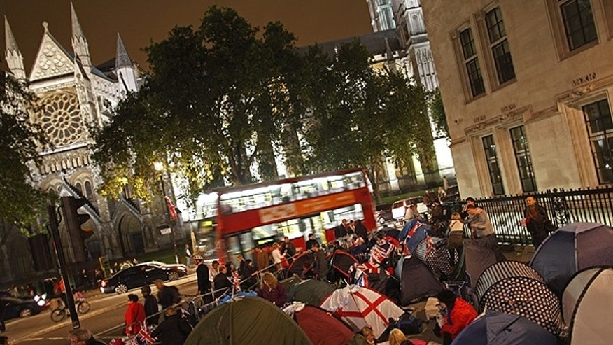 April 28: Royal enthusiasts camp overnight on the Royal Wedding route near Westminster Abbey in London.