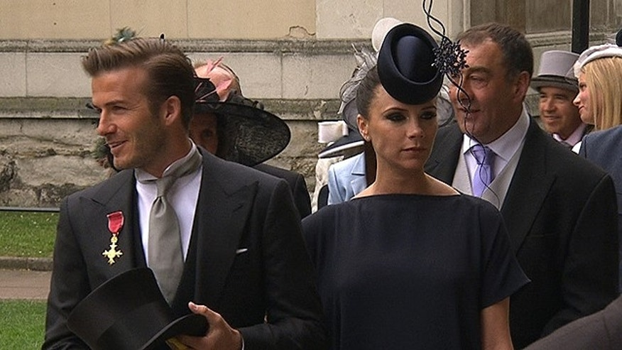 April 29: In this image taken from video, England's soccer star David Beckham, left, and his wife Victoria arrive at Westminster Abbey for the Royal Wedding in London on Friday. (AP)