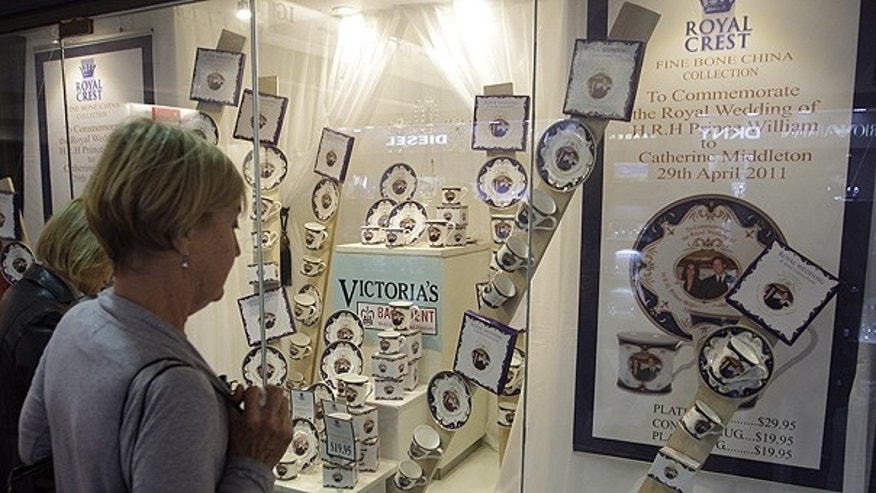 April 28: Shoppers look at a display of commemorative Prince William and Kate Middleton fine china in a store the CBD of Sydney, Australia.