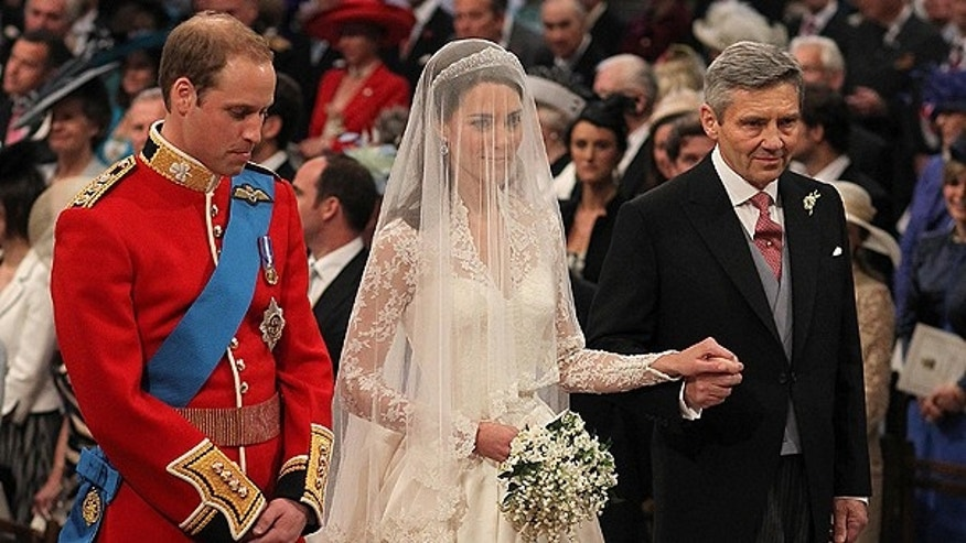 April 29: Britain's Prince William and Kate Middleton, centre, stand at the altar during the service along with Kate's father Michael Middleton.