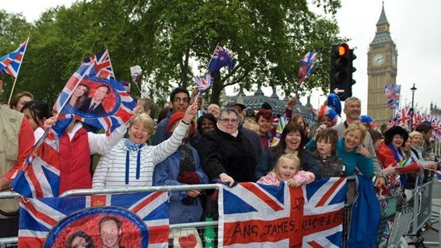April 29: Enthusiastic crowds await the Royal Wedding in Parliament Square, London.
