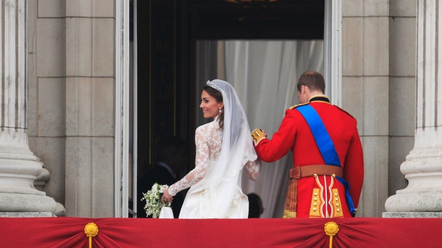 Britain's Prince William and his wife Kate, Duchess of Cambridge go back inside from the balcony of Buckingham Palace after the Royal Wedding in London Friday, April, 29, 2011.