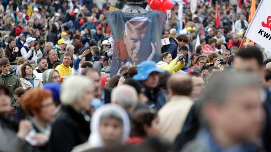 May 1: A picture of late Pope John Paul II emerges from the crowd prior to a solemn celebration led by Pope Benedict XVI where John Paul II will be beatified, in St. Peter's Square at the Vatican in the fastest beatification in modern times.