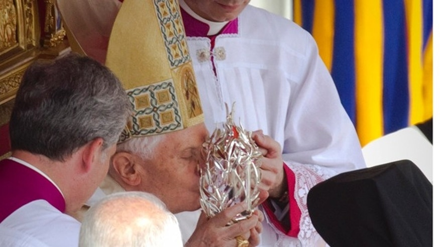 May 1: Pope Benedict XVI kisses the glass reliquary containing the blood of late Pope John Paul II, during the  beatification ceremony in St. Peter's Square at the Vatican in the fastest beatification in modern times.