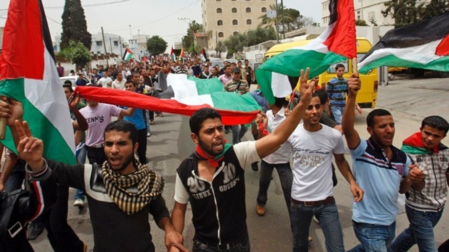 May 4: Palestinians celebrate the signing of a reconciliation agreement between Fatah and Hamas in Gaza City.