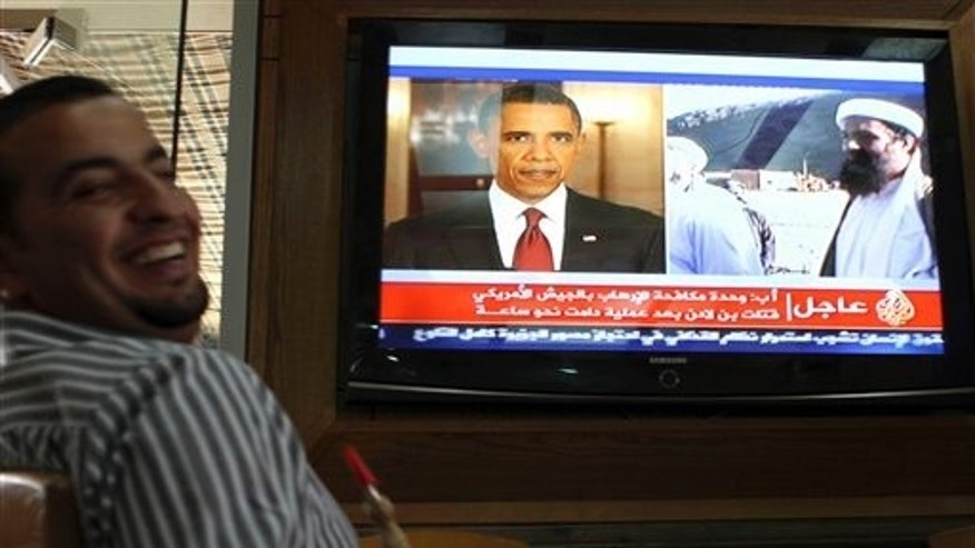 May 2: A Jordanian man reacts as he watches a TV news report about the killing of Osama bin Laden at a coffee shop in Amman, Jordan.