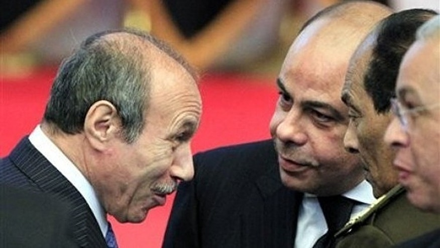 Egyptian Interior Minister Habib al-Adly, left, talks to minister of defense and military production, Field Marshal Hussein Tantawi, second right, during the National democratic party conference in Cairo, Egypt, in this Saturday Dec. 25, 2010 file photo.