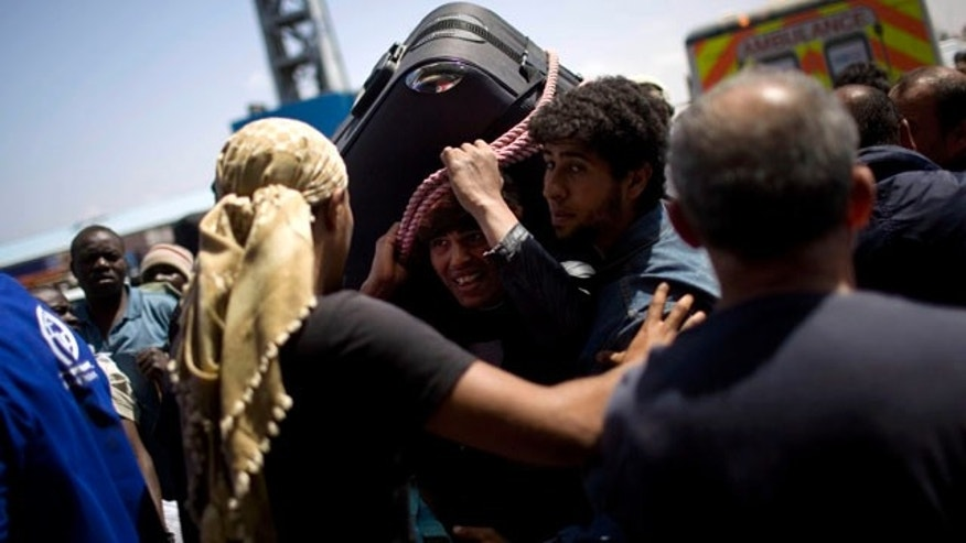 May 4: A Libyan man, center, tries to leave from the besieged city of Misrata, Libya.