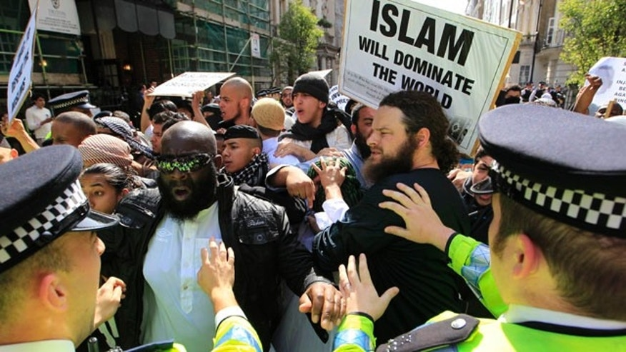 May 6: Police officers try to restrain pro-bin Laden supporters, marching to the U.S. Embassy in London to protest against the killing of Al Qaeda leader Usama Bin Laden.