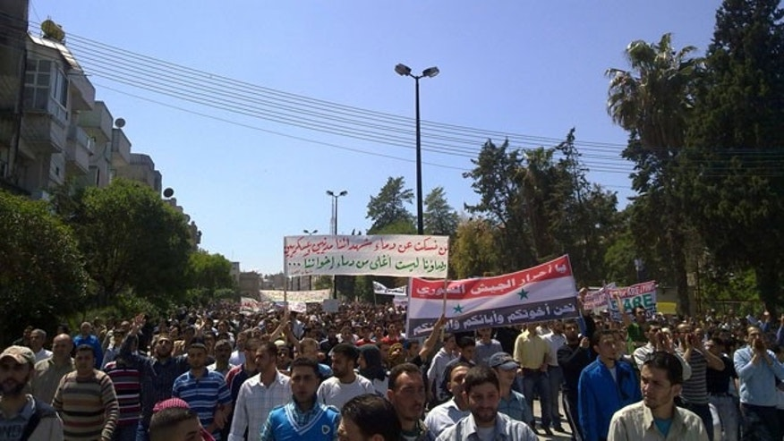 May 6: In this citizen journalism image made on a mobile phone and acquired by the AP, Syrian anti-government protesters rally in the central city of Homs, Syria.