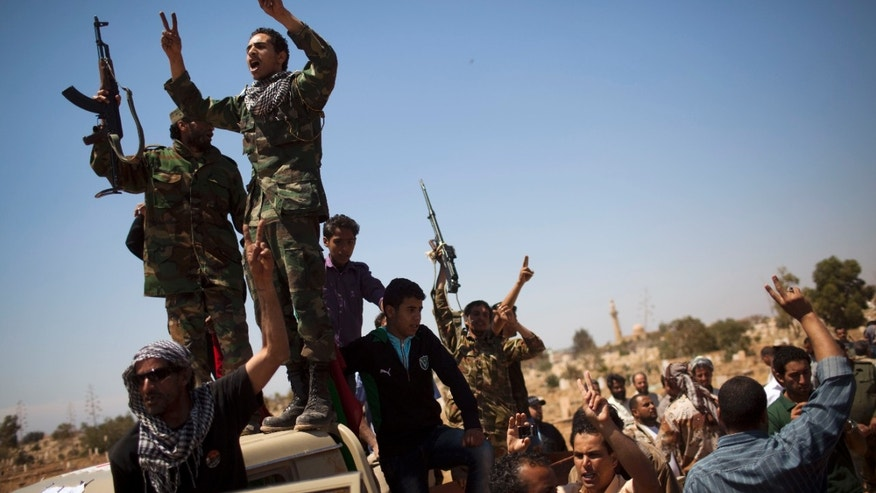 May 10: Rebel fighters chant slogans and fire their machine guns during the funeral of Hussein Saad Al Awami, a rebel fighter who was killed yesterday during fighting against Muammar al-Qaddafi troops, in Benghazi, Libya.
