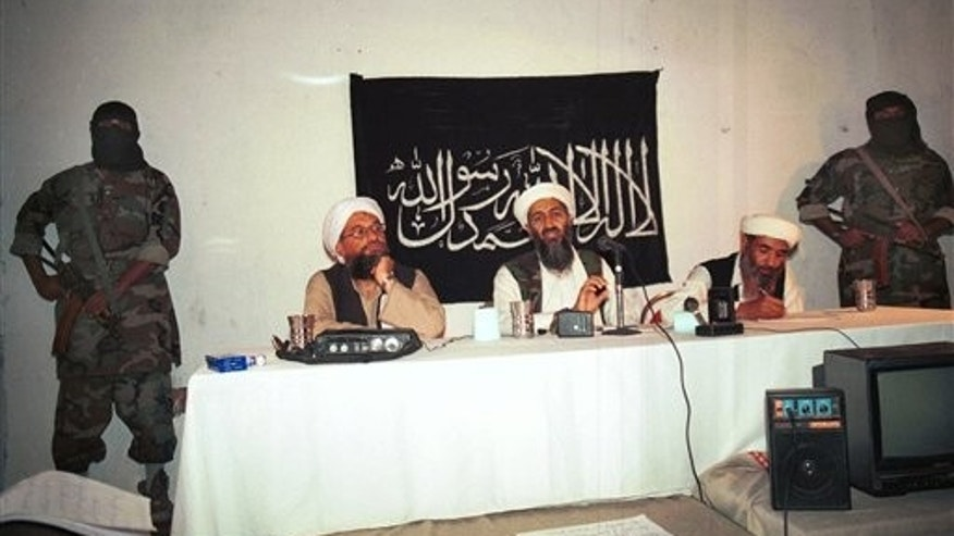 1998: Osama bin Laden flanked by his aides and armed bodyguards in a meeting at an undisclosed location in Afghanistan.