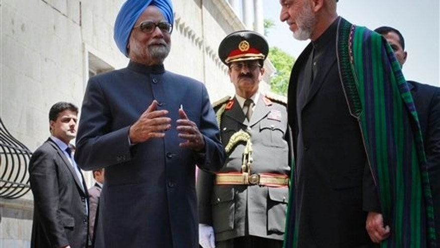 May 12: Indian Prime Minister Manmohan Singh speaks to the media, as Afghan President Hamid Karzai listens to him at the presidential palace in Kabul, Afghanistan.