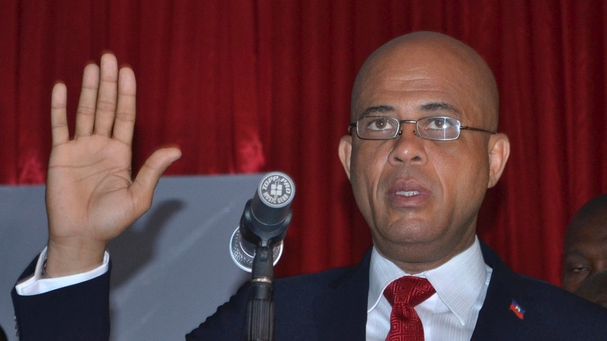 "Michel Martelly is sworn in as Haiti's new president inside a Haitian Parliamentary meeting room in Port-au-Prince, Haiti, Saturday May 14, 2011. Martelly, better known as the popular singer ""Sweet Mickey, defeated his closest rival former, first lady Mirlande Manigat, in a landslide victory with 67.5 percent of the vote in the runoff elections held on March 20th."