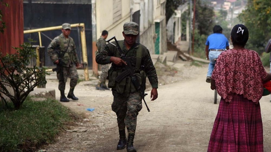 In this photo released by Guatemala's Presidential Press Office, soldiers patrol in Coban, Guatemala, Sunday Dec. 19, 2010. The Guatemalan military declared Sunday a state of siege for 30 days in the northern Alta Verapaz province to reclaim cities that have been overtaken by Mexican drug traffickers, according to authorities. A state of siege allows the army to detain suspects without warrants, conduct warrantless searches, prohibit gun possession and public gatherings, and control the local news media. (AP Photo/Guatemala Presidential Press Office)