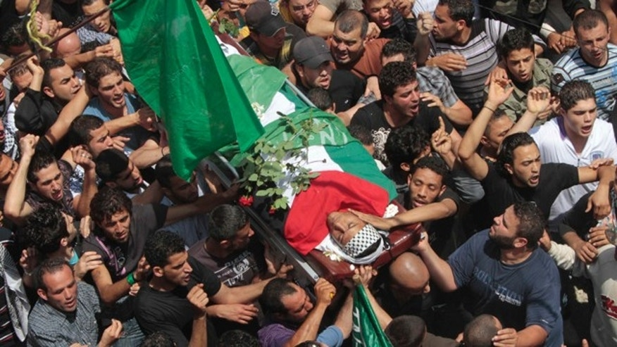 May 16: Palestinian mourners carry the body of a Palestinian man who was killed when Israeli soldiers opened fire on Sunday at protesters who approached the northern Israeli border with Lebanon. Israeli troops clashed with Arab protesters along three hostile borders on Sunday, leaving as many as 12 people dead and dozens wounded.