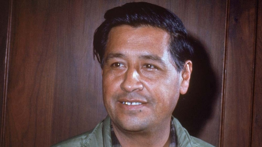 American labor leader Cesar Chavez (1927 - 1993) smiles while standing in front of a wooden wall, 1950s. (Photo by Hulton Archive/Getty Images)