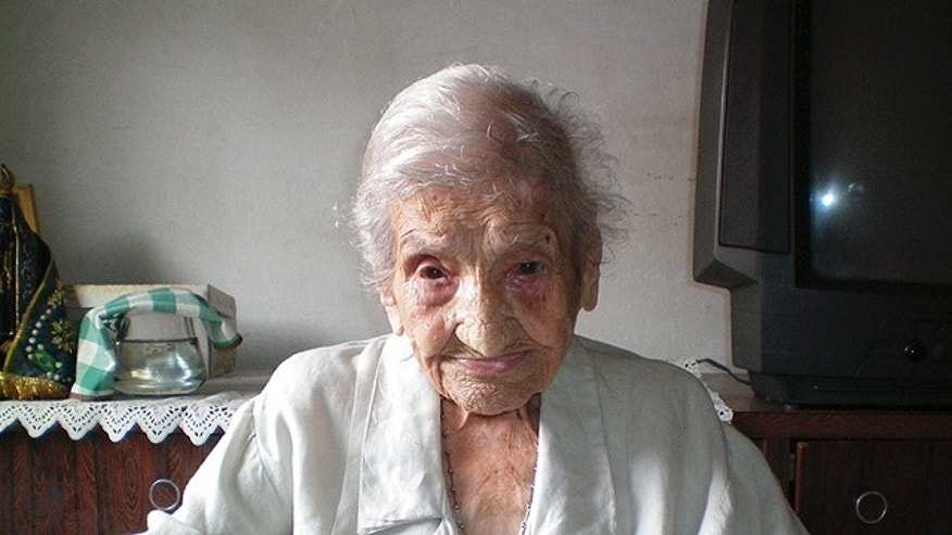 In this photo released by the Guinness World Records organization and taken on March 11, 2011, Brazilian Maria Gomes Valentim, 114, poses for a photo in Carangola, in Brazil's Minas Gerais state. Gomes Valentim is the world's oldest living human, Guinness World Records said Wednesday. (AP/Guinness World Record)