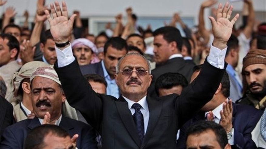 In this April 15, 2011, file photo Yemeni President Ali Abdullah Saleh waves to his supporters during a rally in Sanaa, Yemen. The head of a coalition of Gulf countries seeking to broker an end to Yemen's political crisis gave up on Wednesday and left the country, opposition and government leaders said. Yemen is reeling from three months of massive street protests demanding the ouster of President Ali Abdullah Saleh after more than three decades in power. (AP/File)