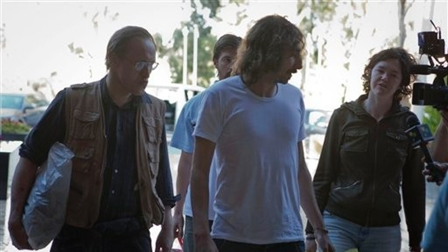 May 18: Freed American freelance journalist Clare Morgana Gillis, Spanish photographer Manu Brabo and British Nigel Chandler arrive at a hotel where most of the international media stays in Tripoli, Libya.